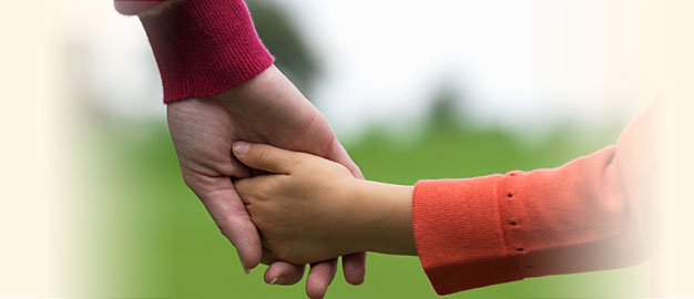 photo of adult hand holding child's hand